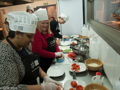 Grating Tomatoes in Paella Class